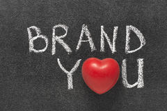 Brand you heart. Brand you phrase handwritten on blackboard with heart symbol instead of O Stock Images