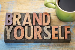 Brand yourself in wood type. Brand yourself word abstract in vintage letterpress wood type stock photography