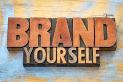 Brand yourself word abstract in wood type Royalty Free Stock Photos