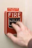 Brandalarm dat wordt getrokken Stock Afbeeldingen