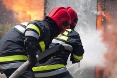 Brandbestrijders Stock Afbeeldingen