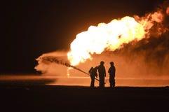Brandbestrijders in actie Stock Afbeeldingen