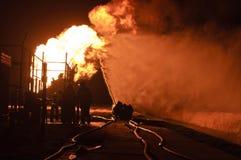 Brandbestrijders in actie Stock Foto