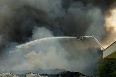 Brandbestrijders in actie Stock Afbeelding