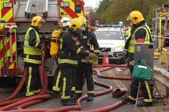 Brandbestrijders bij een incident Stock Foto