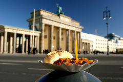 Brandeburg Gate and Currywurst sausage Stock Photos