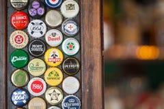 Branded beer bottle caps stock photos