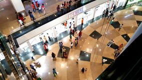 Branded shops in a Shopping Malls in Mumbai. Young people busy suopping with families in a shopping mall in Mumbai Suburbs in India Royalty Free Stock Image