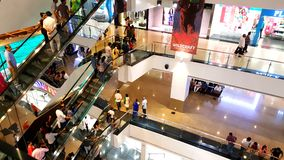 Branded shops in a Shopping Malls in Mumbai. Young people busy suopping with families in a shopping mall in Mumbai Suburbs in India Royalty Free Stock Images