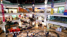 Branded shops in a Shopping Malls in Mumbai. Young people busy suopping with families in a shopping mall in Mumbai Suburbs in India Royalty Free Stock Photo