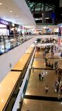 Branded shops in a Shopping Malls in Mumbai. Young people busy suopping with families in a shopping mall in Mumbai Suburbs in India Royalty Free Stock Photography