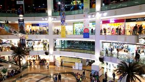 Branded shops in a Shopping Malls in Mumbai. Young people busy suopping with families in a shopping mall in Mumbai Suburbs in India Stock Photography