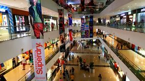 Branded shops in a Shopping Malls in Mumbai. Young people busy suopping with families in a shopping mall in Mumbai Suburbs in India Stock Images
