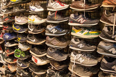 Branded sneakers and jogging shoes. Shoes at Sunday market in Bangkok, Thailand Stock Photos