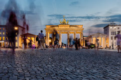 Brandemburg Gate sunset. Berlin- Germany - AUGUST, 10, 2015: Brandenburg Gate view at the sunset with long exposure in order to capture de movement of the Royalty Free Stock Photos