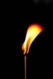 Branden flammar på svart bakgrund Fotografering för Bildbyråer
