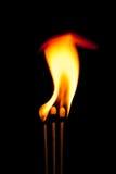Branden flammar på svart bakgrund Royaltyfria Foton