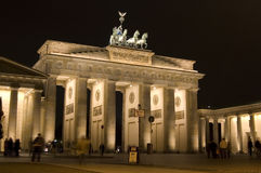 Brandenburg Gate. The famous Brandenburg Gate in Berlin, Germany brightly lit at night time Stock Image