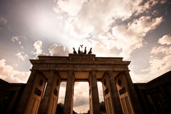 Brandenburg Gate against a dramatic sky. Low angle view of the Brandenburg Gate, or Brandenburger Tor, in Berlin against a dramatic evening sky with clouds Royalty Free Stock Photo