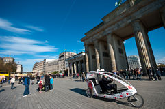 Brandenburg Gate, Berlin. Wide angle view of Berlin Brandenburg Gate (18 March Plaza) with tourists gathered and sightseeing bike stock photos