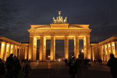 The Brandenburg Gate, Berlin. The Brandenburg Gate (German: Brandenburger Tor) is a former city gate and one of the main symbols of Berlin and Germany. It is stock photography
