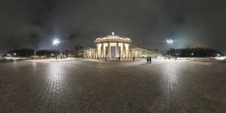 Brandenburg Gate in Berlin. Germany. Panorama is made late cloudy January evening. 360 degree panoramic composition royalty free stock images