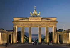 Brandenburg Gate in Berlin. Illuminated Brandenburg Gate in Berlin from the Eastern side at dusk royalty free stock photos