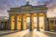 The Brandenburg Gate in Berlin at amazing sunrise, Germany. Tor brandenburger landmark people capital sunny statue old sunset travel architecture building urban stock photo