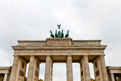 Brandenburg gate in Berlin. Brandenburg gate in Belin in cloudy autumn day stock photo