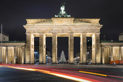 Brandenburg Gate in Berlin with Christmas tree and blurred traffic lights Stock Image