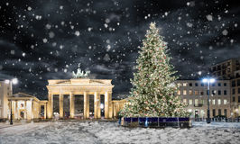 Brandenburg Gate in Berlin, with Christmas tree and snow. Brandenburg Gate in Berlin, Germany, with Christmas tree and snow Stock Images