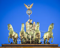Brandenburg Gate, Berlin. Crescent moon and pretty night time illuminations of the Brandenburg Gate (1788) inspired by Greek architecture, built as a symbol of stock images