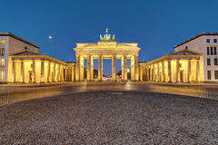 The Brandenburg Gate in Berlin at dawn. The famous Brandenburg Gate in Berlin illuminated at dawn stock image