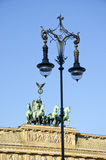 Brandenburg gate in Berlin and decorative lamp. Sculpture group in Germany stock photos
