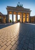 Brandenburg Gate, Berlin. Dramatic sunlit Brandenburg Gate (1788), Berlin, Germany stock photo