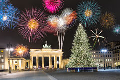 Brandenburg Gate in Berlin, with fireworks and Christmas tree stock images