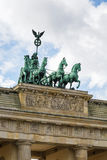 Brandenburg Gate, Berlin. The Brandenburg Gate is a former city gate, rebuilt in the late 18th century as a neoclassical triumphal arch, and now one of the most stock photos
