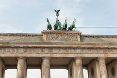 Brandenburg Gate in Berlin. The Brandenburg Gate (German: Brandenburger Tor) is a former city gate, rebuilt in the late 18th century as a neoclassical triumphal stock photography