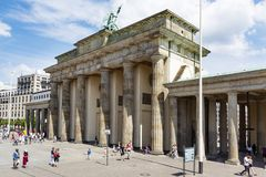 Brandenburg Gate in Berlin, Germany. BERLIN, GERMANY - MAY 25, 2018: Tourists at the popular Brandenburg Gate in Berlin, one of the main landmarks in the city stock photo