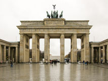 Brandenburg Gate - Berlin, Germany. Chariot with the goddess of victory Victoria on the Brandenburg gate, Berlin, Germany, on a cloudy day royalty free stock photography