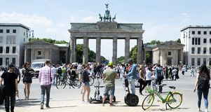 Brandenburg Gate in Berlin, Germany. BERLIN, GERMANY - MAY 24, 2018: Tourists at the popular Brandenburg Gate in Berlin, one of the main landmarks in the city royalty free stock photography