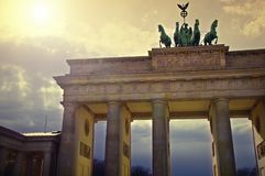 The Brandenburg Gate in Berlin, Germany. Brandenburg Gate is Berlin`s most famous landmark. A symbol of Berlin and German division during the Cold War, it is now stock photography