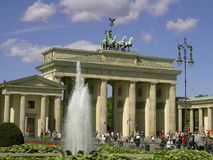 The Brandenburg Gate. BERLIN, GERMANY: The Brandenburg Gate at summer with fountain and tourists Stock Images