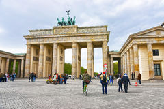 Brandenburg Gate in Berlin in Germany. The Brandenburg Gate is a triumphal arch, a city gate in the center of Berlin. It is one of the most known sites in royalty free stock photo