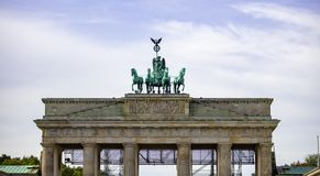 Brandenburg Gate In Berlin. Historic symbol in Germany. Cloudy sky background. royalty free stock photo