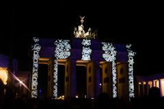BRANDENBURG GATE, BERLIN - October 14, 2017: Festival of lights. Festival of lights in Berlin. Illuminated brandenburg gate with people watching stock images
