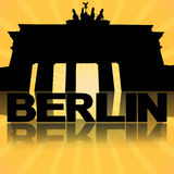Brandenburg Gate Berlin reflected with sunburst Stock Images