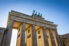 Brandenburg Gate, Berlin. Sunlight illuminating Brandenburg Gate (1788) inspired by Greek architecture, built as a symbol of peace and nationalism, now an emblem royalty free stock image
