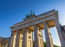 Brandenburg Gate, Berlin. Sunlight illuminating Brandenburg Gate (1788) inspired by Greek architecture, built as a symbol of peace and nationalism, now an emblem royalty free stock images