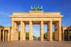 The Brandenburg Gate in Berlin at sunrise stock photos